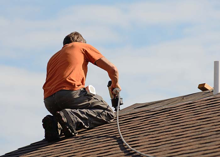roofing contractor working on shingle replacement in Newton